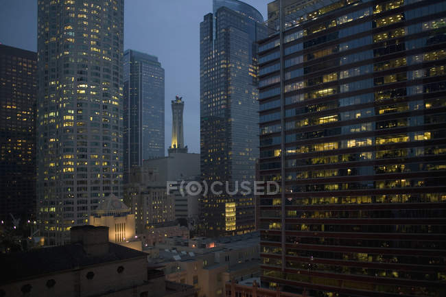 Illuminated skyscrapers in downtown district at night, Los Angeles, California — Stock Photo