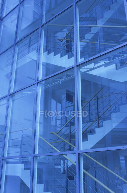 Glass facade and indoor stairwell — Stock Photo