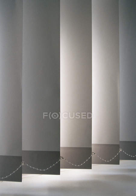Full frame shot of low section of vertical blinds — Stock Photo