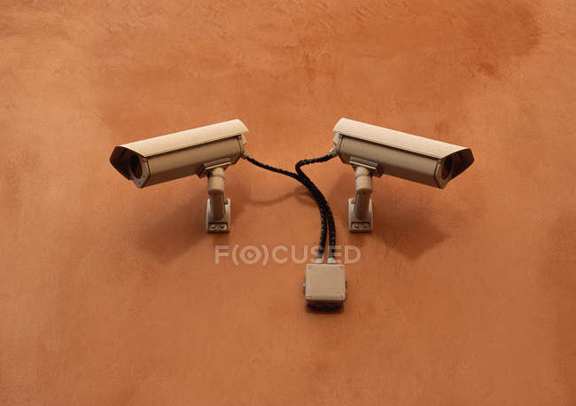 TV cameras on orange wall — Stock Photo