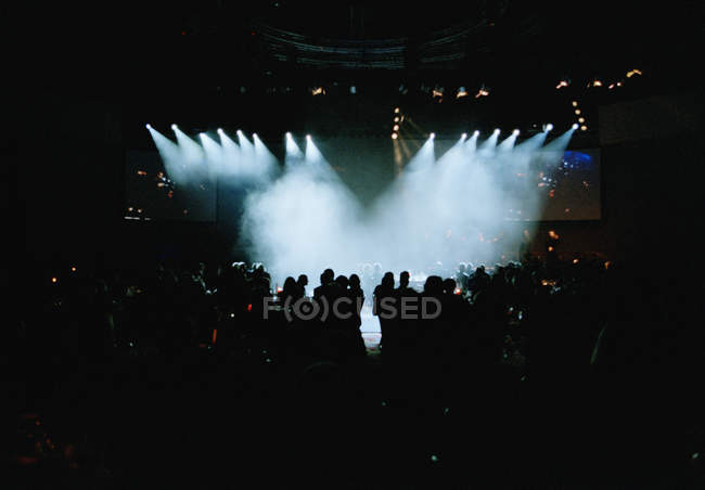 Distant view of people silhouettes at nightclub — Stock Photo