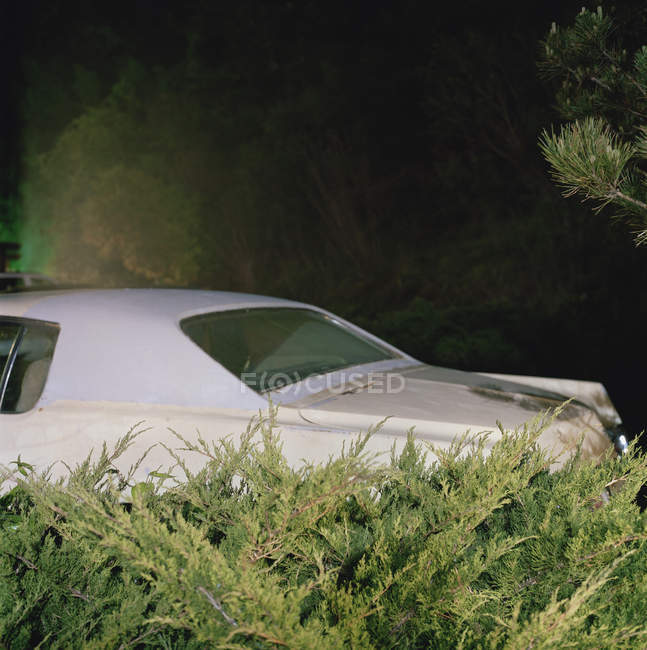 Cropped image of car parked in driveway at night — Stock Photo