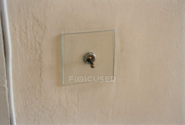 Close up view of old-fashioned light switch on wall — Stock Photo