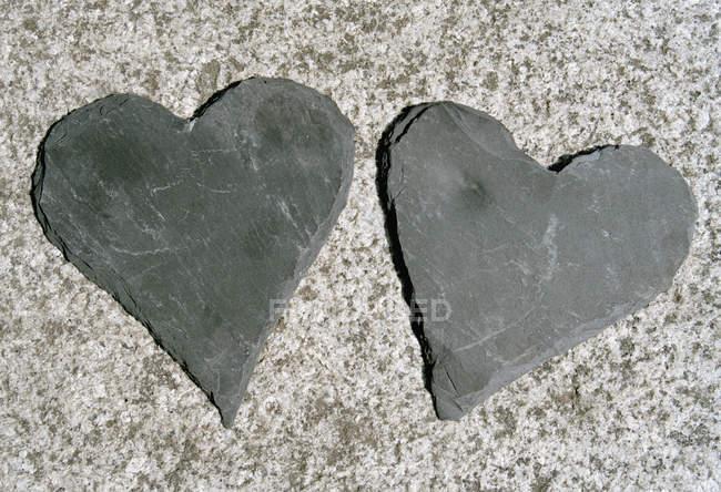 Dois de coração em forma de pedras cinzentas — Fotografia de Stock
