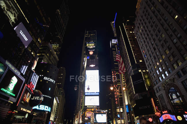 Low angle view of illuminated with advertisement displays facade at Times Square, New York — Stock Photo