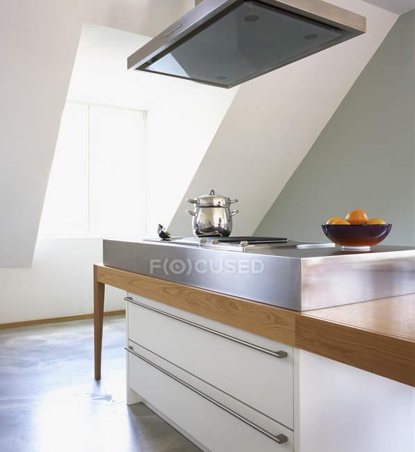 Shiny pot on stove at modern kitchen interior — Stock Photo