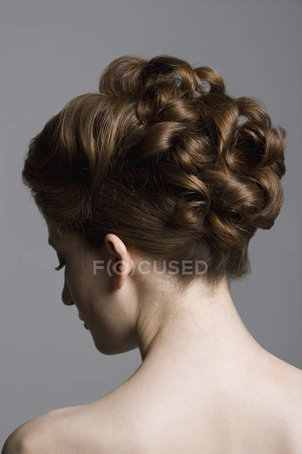 Rear view of young woman with elegant hairstyle — Stock Photo