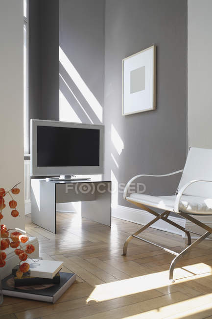 Television and arm chair in a modern living room — Stock Photo