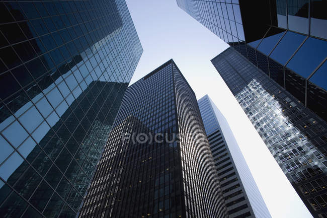 Low angle view of building facades in financial district — Stock Photo