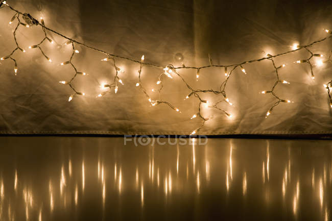 Detail of string of lit fairy lights — Stock Photo
