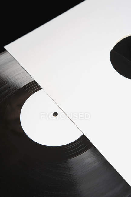 Vinyl record in white paper cover — Stock Photo
