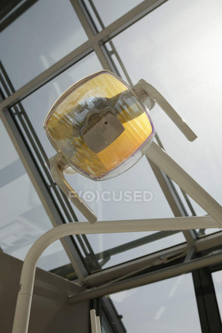 Low angle view of light lamp over window — Stock Photo