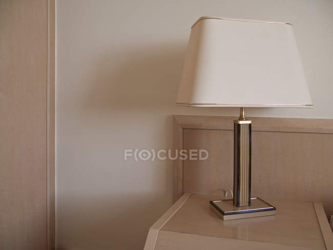 Close up view hotel lampshade on beige table — Stock Photo