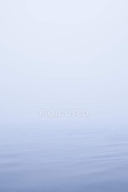 Merge of Baltic sea and misty sky — Stock Photo