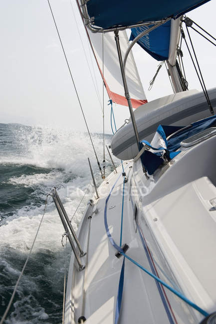 View from sailboat sailing on sea though waves — Stock Photo