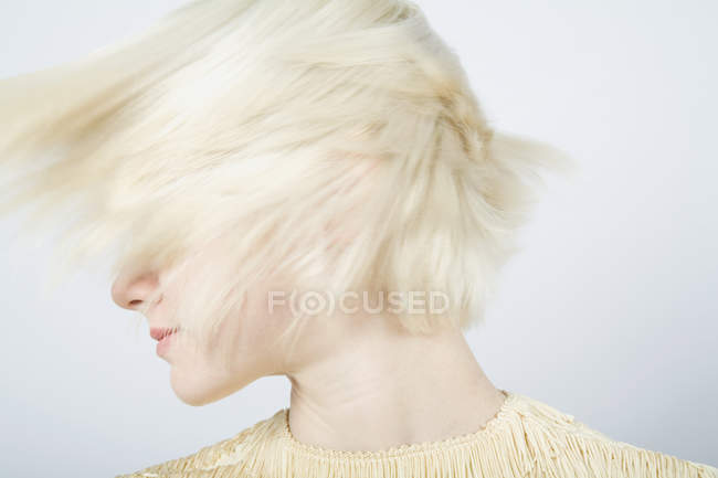 A young woman shaking her hair — Stock Photo