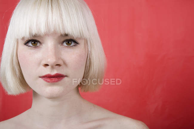 A portrait of a young woman with a blonde bob — Stock Photo