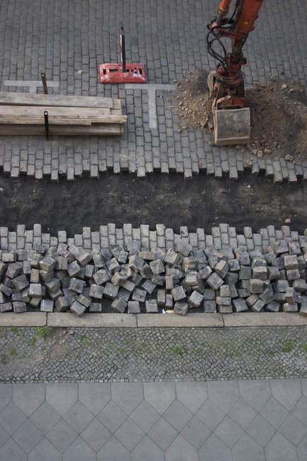 Aerial view of excavation of cobblestone street — Stock Photo