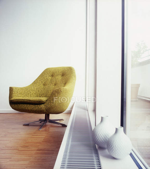 Interior with arm chair next to window — Stock Photo