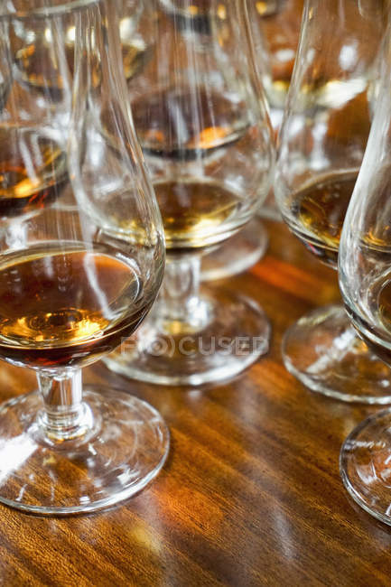 Close up view of wine in glasses on wooden table at bar — Stock Photo