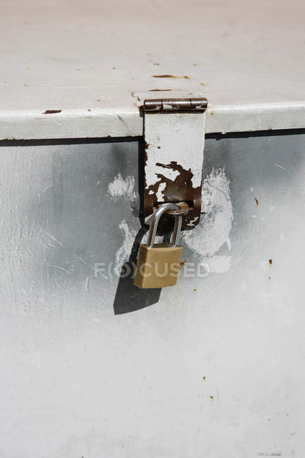 Close up view of padlock on metal container — Stock Photo
