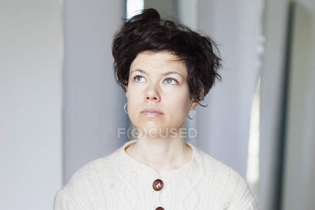 Portrait of thoughtful woman with short hair looking away — Stock Photo