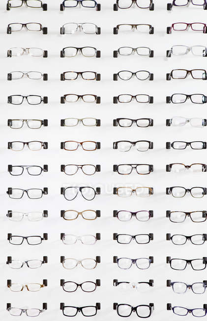 Eyeglasses on display in eyewear store — Stock Photo