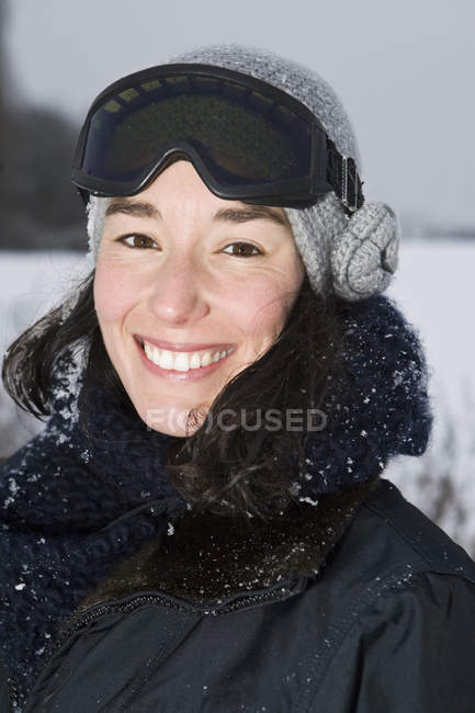 A woman outdoors in winter, head and shoulders, portrait — Stock Photo
