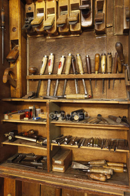 Various tools at antique woodworkers cabinet — Stock Photo