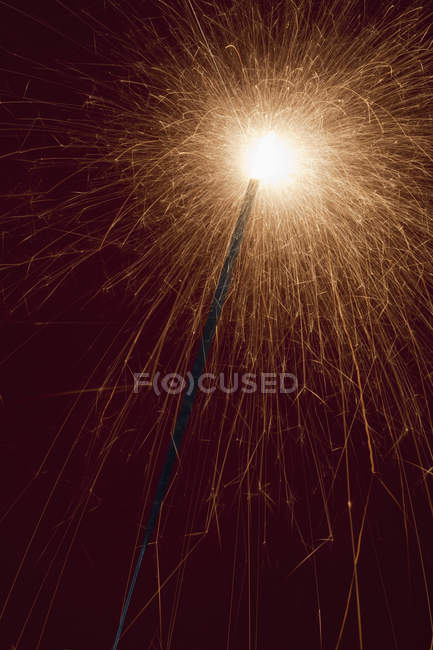 Low angle view of lit sparkler — Stock Photo