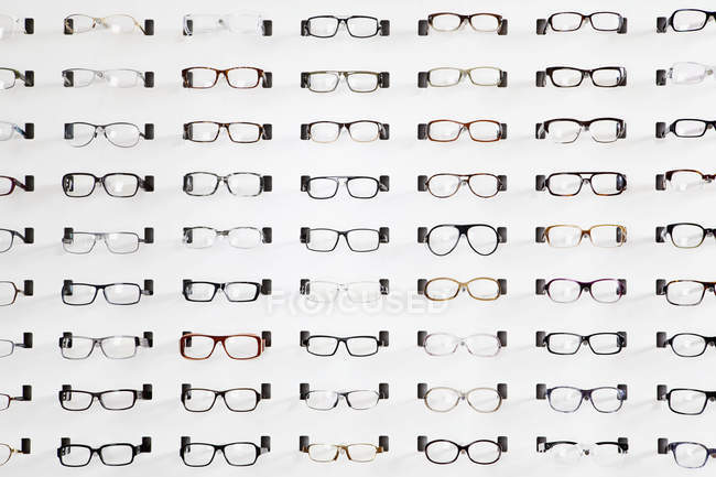 An eyeglasses display in eyewear store — Stock Photo