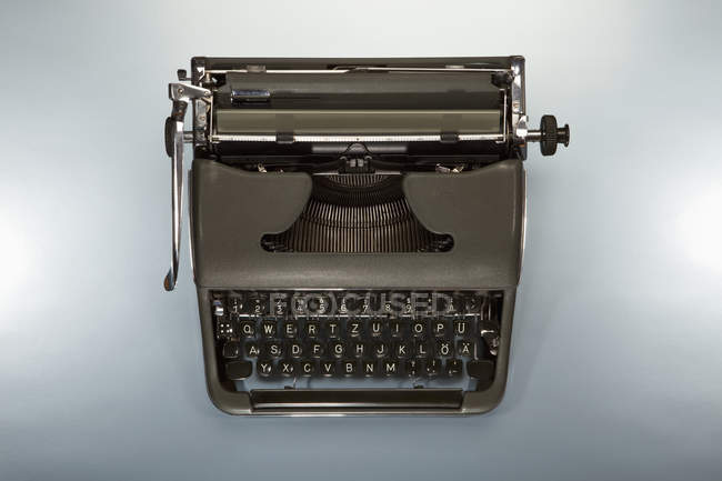 Top view of old-fashioned typewriter on white background — Stock Photo