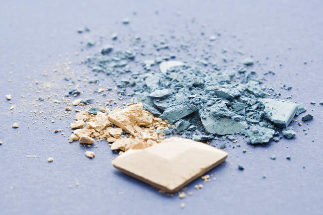 Crushed blue and beige eye shadow — Stock Photo