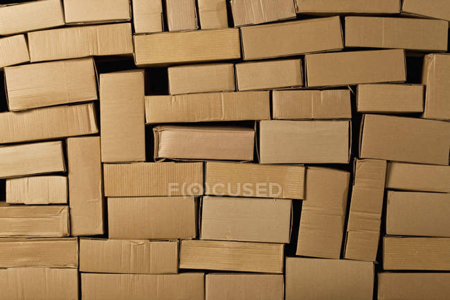 Full frame shot of stacked cardboard boxes — Stock Photo