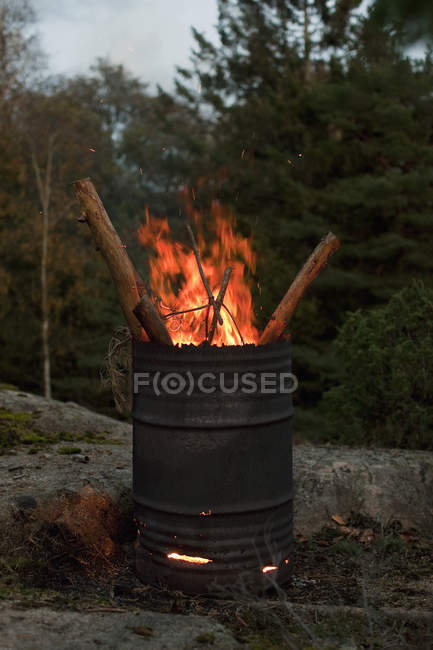Fire burning in oil drum at nature — Stock Photo
