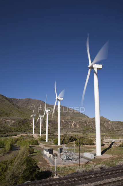 Row of wind turbines at mountain valley — Stock Photo