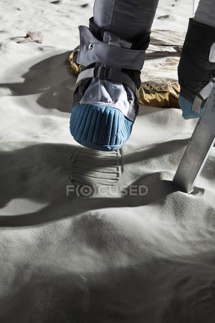 Crop astronaut climbing ladder of lunar lander — Stock Photo