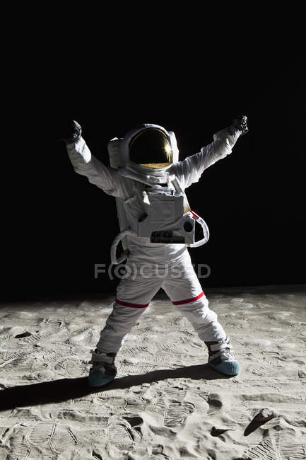 Astronaut on moon with arms raised victory gesture — Stock Photo