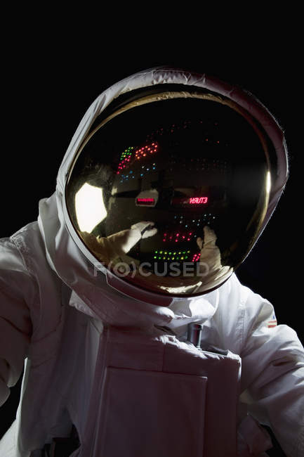 Control panel reflecting in astronaut's helmet in space — Stock Photo