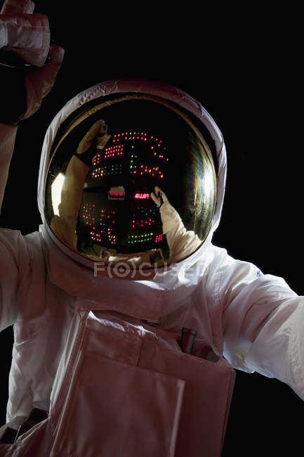 Control panel reflecting in helmet of astronaut in space — Stock Photo