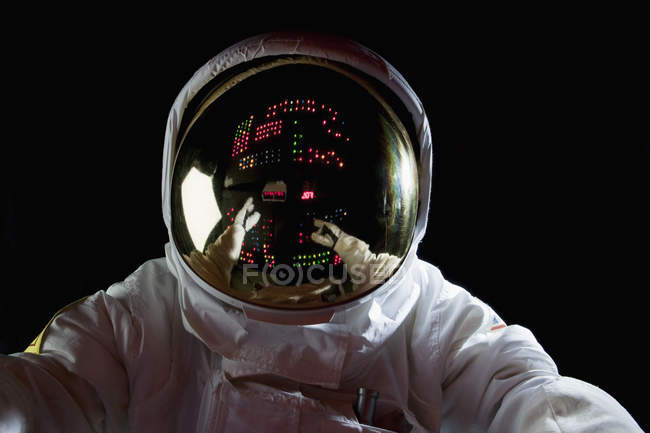 Astronaut in space with control panel reflecting in helmet — Stock Photo