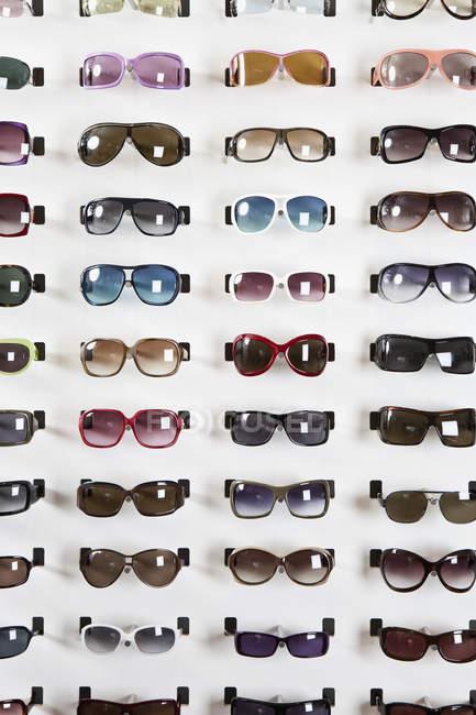 Sunglasses display in eyewear store — Stock Photo