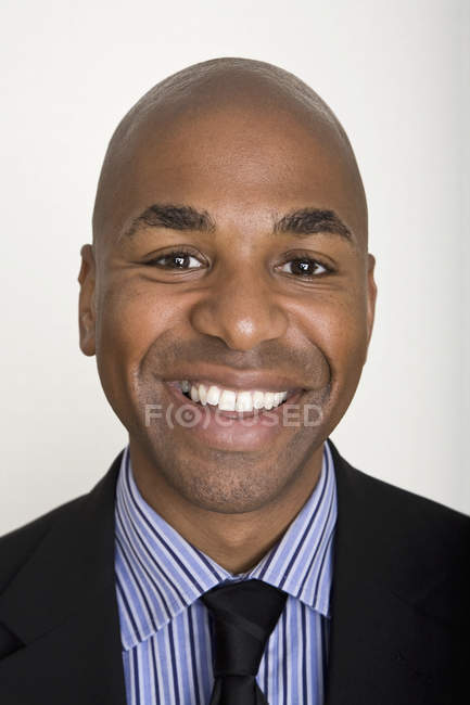 Portrait of  smiling man againsy white background — Stock Photo