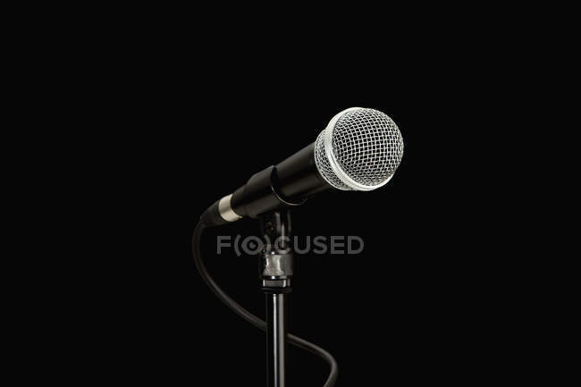 Microphone on stand over black background — Stock Photo