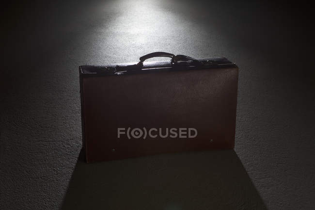 Businessbriefcase on grey spot light — Stock Photo
