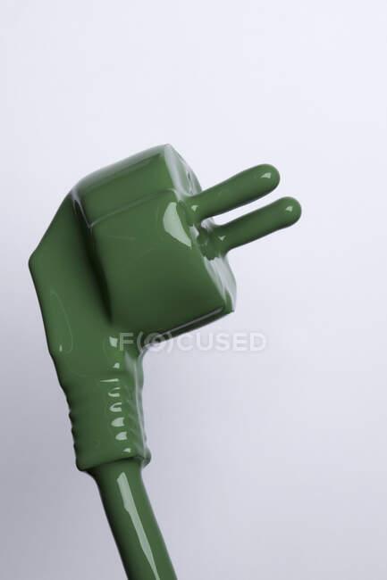 Spina di uscita verde sullo sfondo — Foto stock