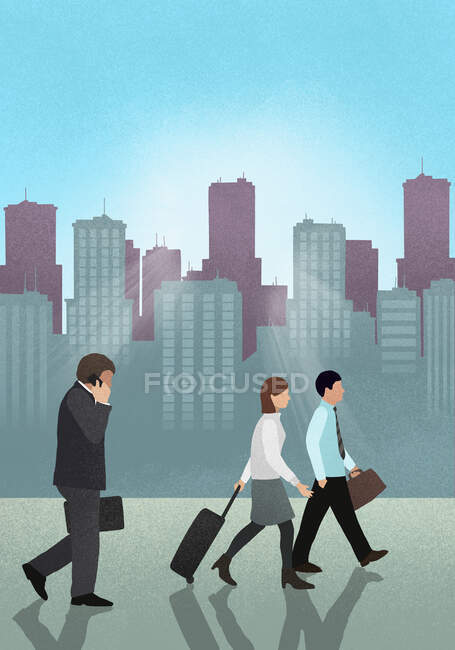 Side view of business people walking against skyscrapers — Stock Photo