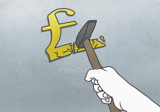Cropped hand breaking Pound symbol with hammer on gray background — Stock Photo
