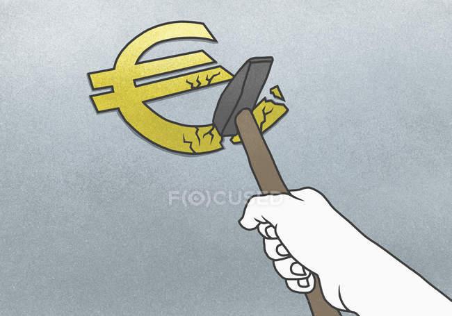 Hand with hammer crashing euro — Stock Photo