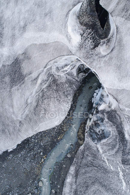Drone view of water stream flowing through glacier — Stock Photo
